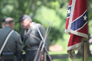 Civil War reenacts in Confederate uniforms