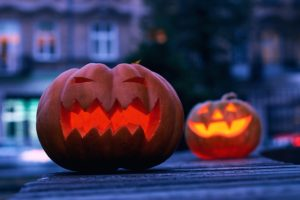 ghost tours on historic street with pumpkins