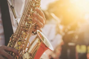 Close up saxophone musician's hands playing music