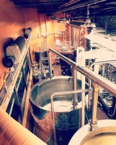 large tanks used for distilling bourbon at distillery on Kentucky Bourbon Trail