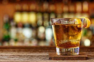 bourbon cocktail on wooden bar on the Kentucky Bourbon Trail