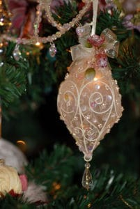 Beautiful and delicate Victorian ornament hanging from a Christmas tree in My Old Kentucky Home