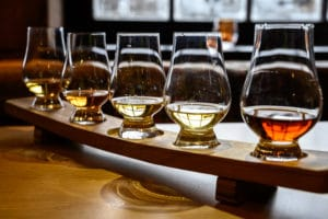 Glasses of bourbon tasting at distillery while staying the best bed and breakfast near the Kentucky Bourbon Trail