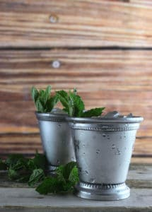 mint julep cocktails cups with crushed ice and fresh mint
