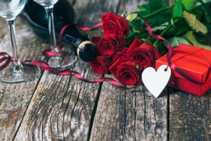 Romantic gifts of wine roses and red gift box